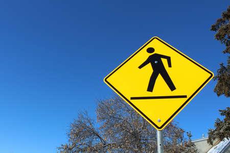 Crosswalk on a Yellow Diamond Sign Stock Photo