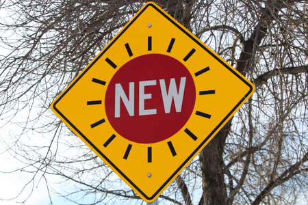 rhomb: New Traffic Signal Sign Against Tree Branches Stock Photo