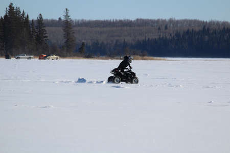 Pushing a Quad out of a Rut in the Middle of a Frozen Lake
