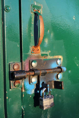 Closeup of a Colorful Bolt Lock on a Shed