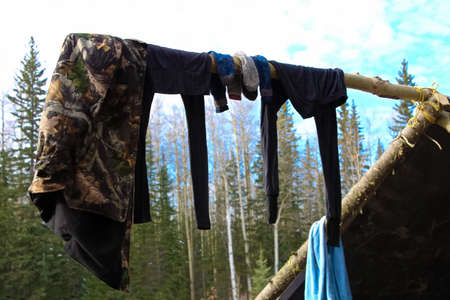 eliminate: Clothes Drying on a Pole at a Hunting Camp
