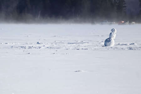frozen lake: Lonely Snowman on the Middle of a Frozen Lake