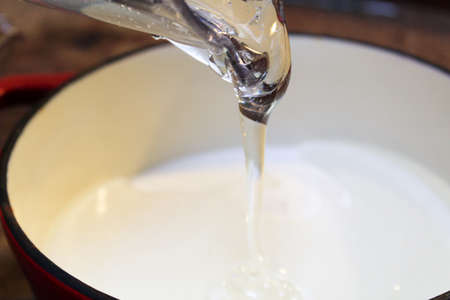 Pouring Clear Thick Liquid into a Pot.