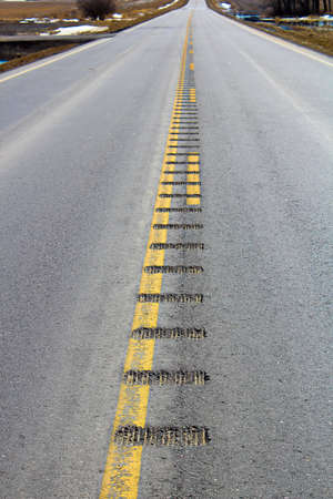 Center line rumble strips down a lonely country road.
