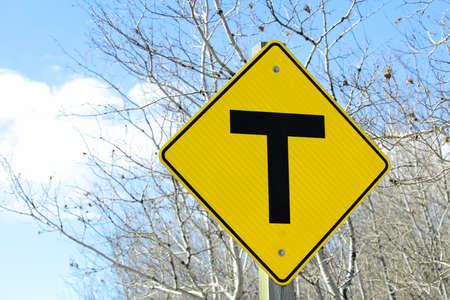 T crossing road sign