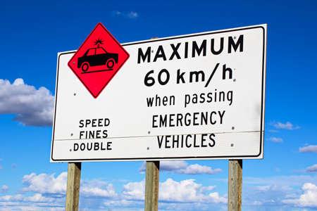 Maximum speed while passing emergency vehicles sign. Stock Photo