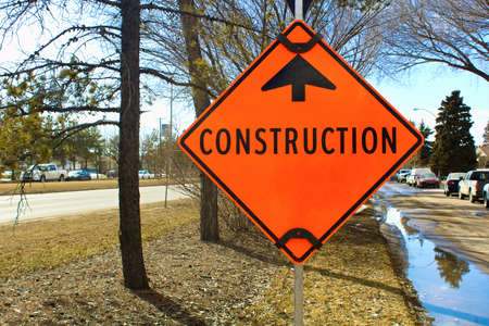 Temporary construction ahead sign on a side street. Stock Photo