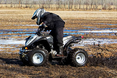 Spring time quading through the mud Stock Photo