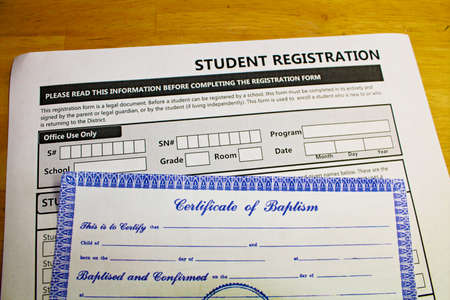 Proving faith in order to register in schools. Stock Photo