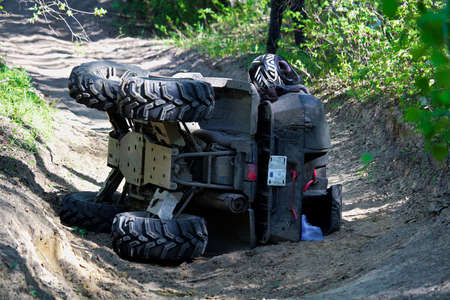 A quad on its side after it has been accidentally flipped. 스톡 콘텐츠