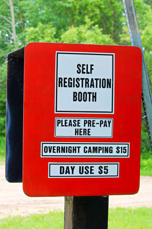 Booth to collect fees for camping and day use at a campground. Archivio Fotografico
