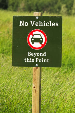 No vehicles beyond this point sign. Imagens