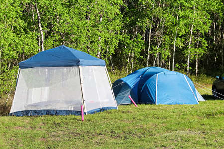 Camping with a tent and having a bug screen to retreat to. 版權商用圖片