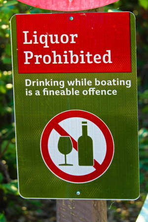 A liquor prohibited, drinking while boating is an offense sign. Stock Photo
