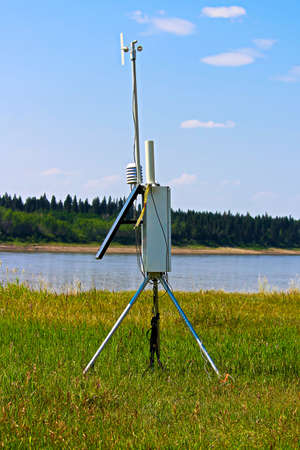 A weather monitoring station beside a river. Stock Photo