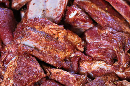 Closeup of pork ribs with a dry rub.