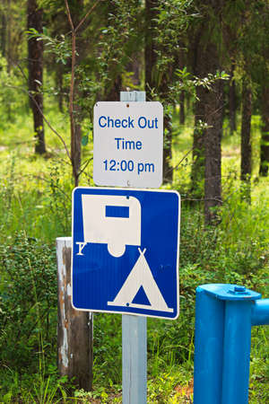 A camping check out time 12:00 pm message sign. Stock Photo