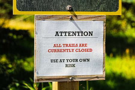Attention all trails are currently closed sign. Stock Photo