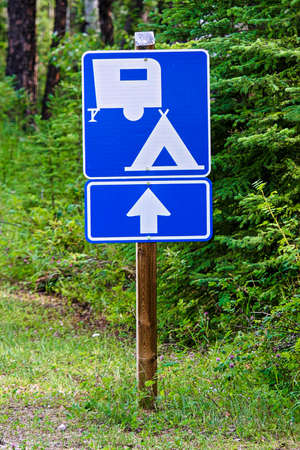 A blue information sign indicating camping ahead. Stock Photo