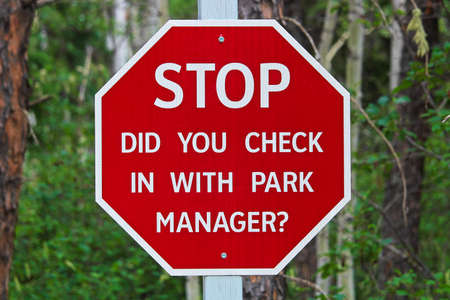A stop, did you check with the park manager sign.