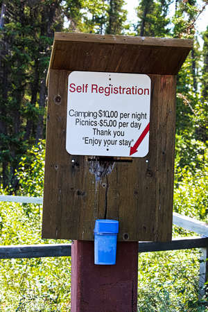 A self registration box with prices and money deposit.