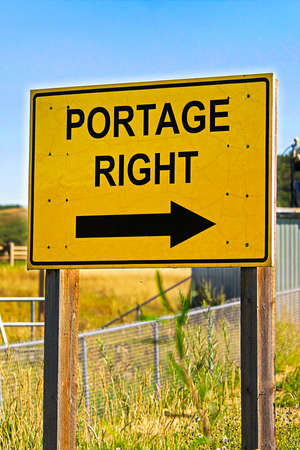 A yellow portage right sign with an arrow.