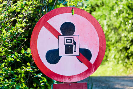 A no gas motors sign at lake with a small hook hanging. Stock Photo