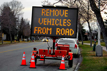 A remove vehicles from road billboard in spring. Stock Photo