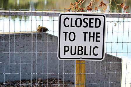 A lakeside path with a closed to the public sign. Stock Photo