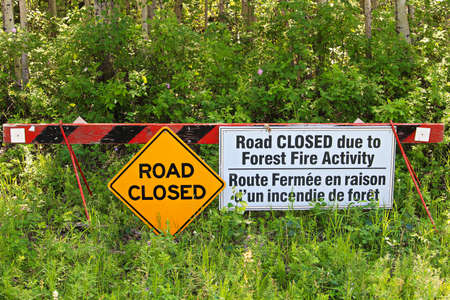 A road closed due to fire activity sign. Stock Photo