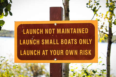 A launch not maintained use at own risk sign. Stock Photo