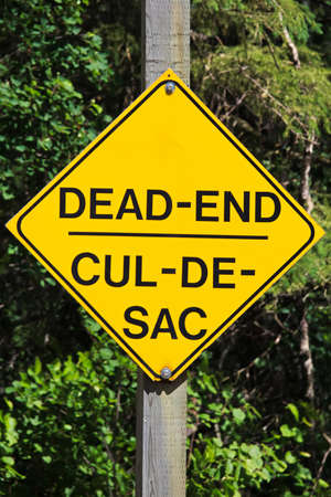 Closeup of a yellow Dead End sign Stock Photo