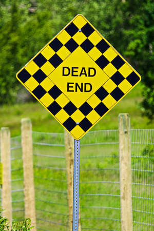 Closeup of a checkered Dead End sign Stock Photo