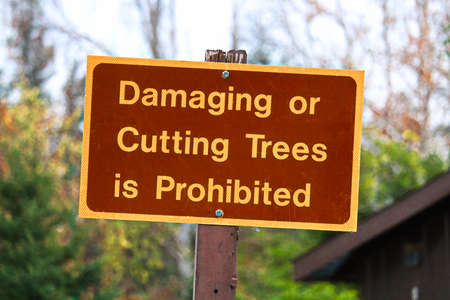 A Damaging or Cutting Trees is Prohibited sign