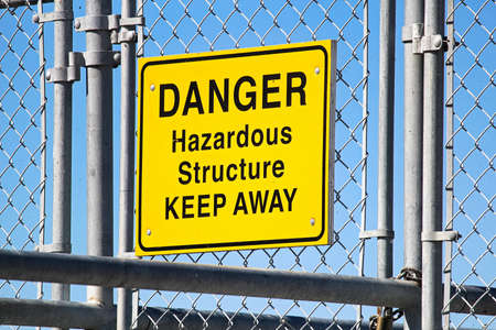 A Danger Hazardous Structure Keep Away sign