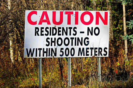 A Cautions Residents, No Shooting Within 500 Meters sign