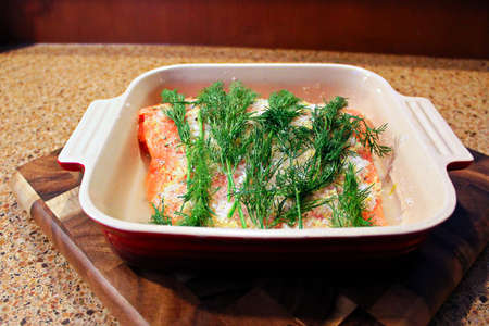 A dish of salmon placed in a dish to be made into gravlax