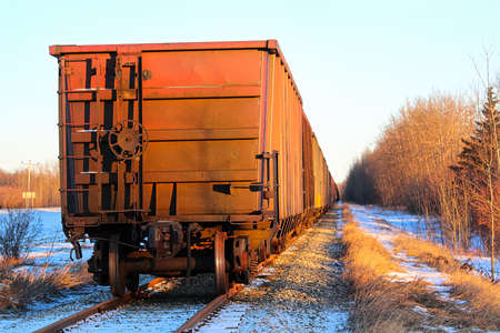 A grain train car waiting on a track