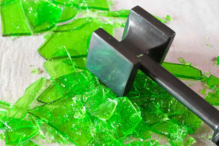 Cracking broken glass candy with a mallet. Stock Photo