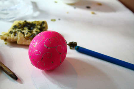 Decorating easter eggs with beeswax and a stylus