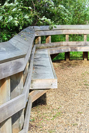 A bench for resting built into a fence