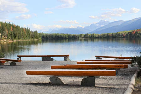 Rows of benches look over a magestic mountain view