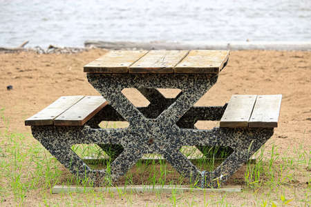 View of a cement picnic table at a beach