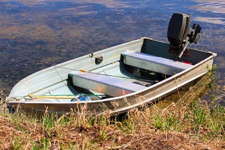 An aluminium fishing boat at the shore