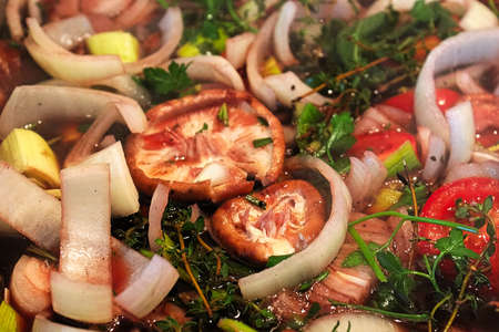 A background of various vegetables herbs and mushrooms.