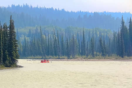A red raft floating down a river