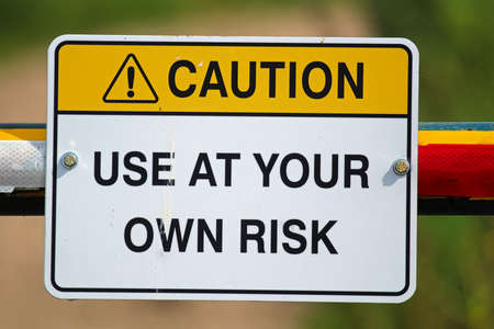 A caution use at your own risk sign