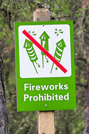 Closeup of a green fireworks prohibited sign