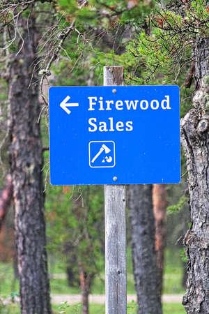 Closeup of a blue firewood sales sign Stock Photo
