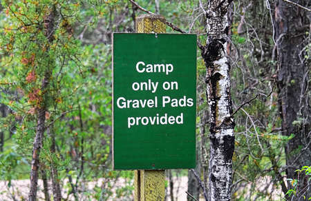 A camp only on gravel pads provided sign